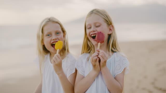 Happy Little Girls Eating Ice cream