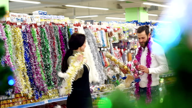 Happy loving couple buying Christmas decorations and gifts for Christmas.