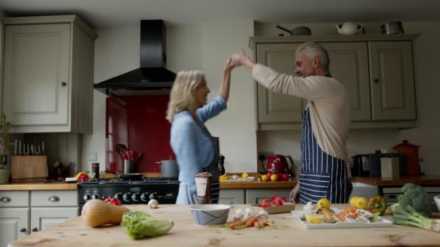 happy loving couple enjoying date night cooking at home and dancing - date night stock videos & royalty-free footage