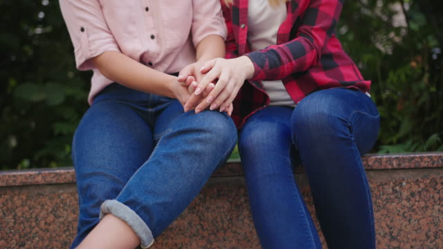 Happy loving homosexual lesbian LGBT couple talking in the city. Pride concept Happy loving homosexual lesbian LGBT couple talking in the city. Pride concept. bisexuality stock videos & royalty-free footage
