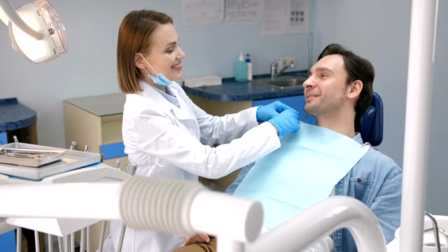 happy male patient smiling after dental treatment - dentist stock videos & royalty-free footage