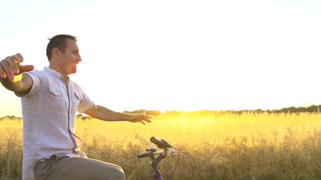 HD SUPER SLOW MO: Happy Man Cycling Without Hands video