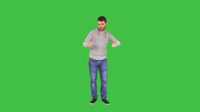 Happy Man dances like he is a robot Happy man in casual clothes dances like he is a robot isolated on green screen background full length stock videos & royalty-free footage