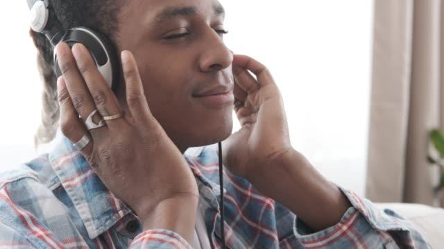 Video Happy man listening music on headphones