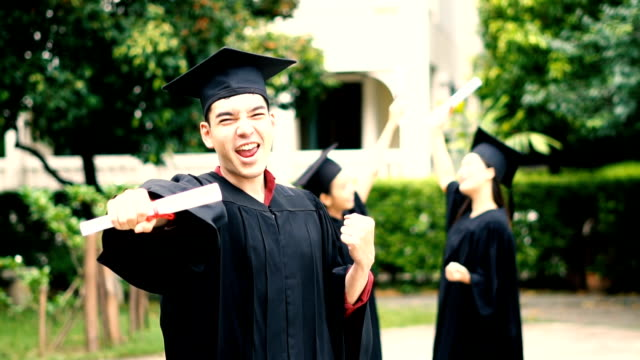 happy man on his graduation day university. education and people - кепка стоковые видео и кадры b-roll