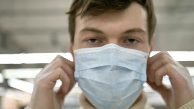 happy man takes off the mask from face smiles. coronavirus is over - vídeo