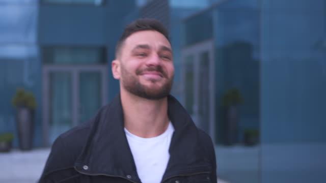 Happy man walking on city street video