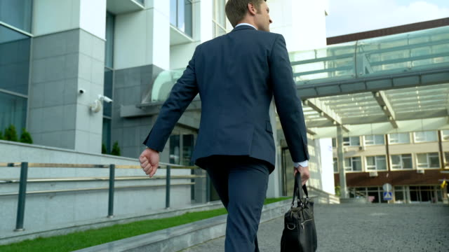 happy man walking to office building, beginning of work day, successful future - sales stock videos & royalty-free footage