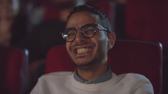 Happy Man Watching Comedy Film at Cinema - vídeo