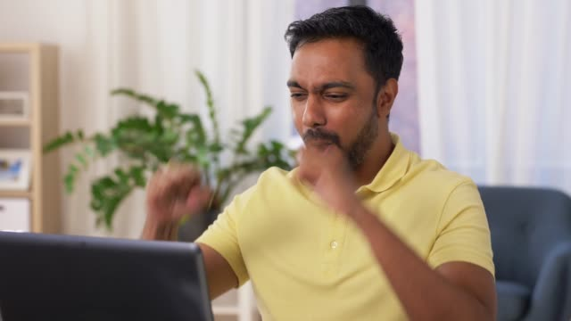 happy man with laptop working at home office technology, remote job and lifestyle concept - happy smiling indian man with laptop computer working and celebrating success at home office ecstatic stock videos & royalty-free footage