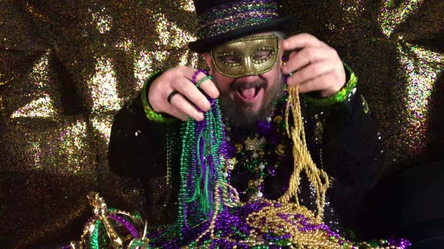 Happy Mardi Gras man in fancy costume with top hat
