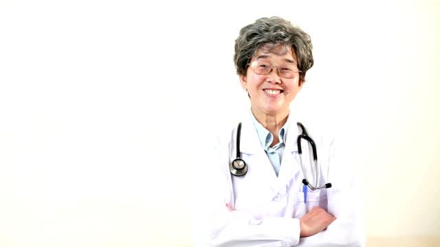 happy mature doctor - mature women studio grey hair bildbanksvideor och videomaterial från bakom kulisserna