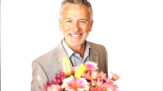 Happy mature man giving bouquet video