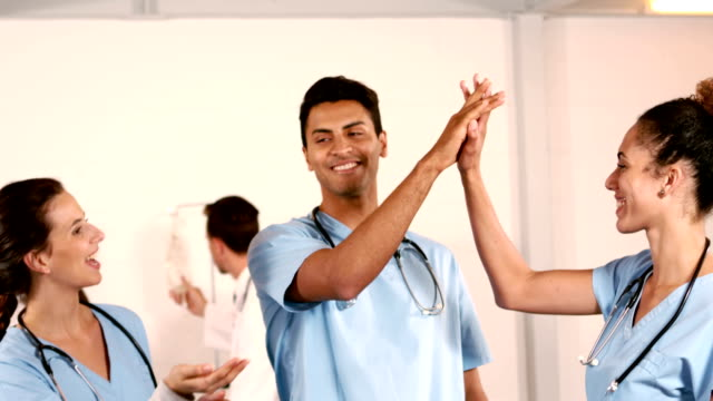 Happy medical team doing high five video