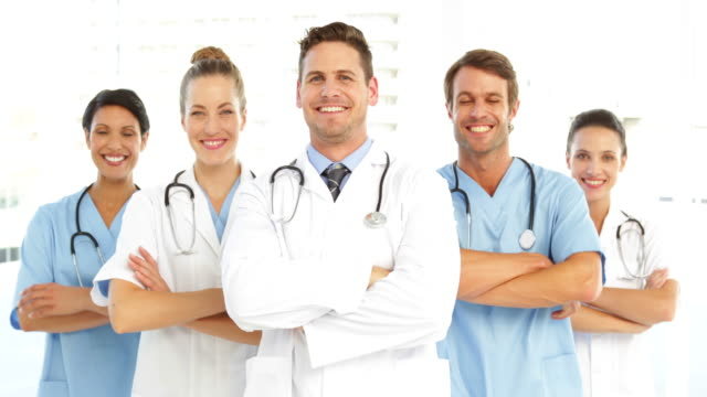 Happy medical team with arms crossed video