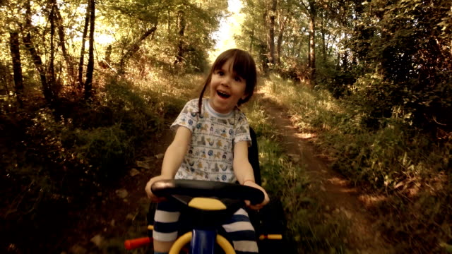 stockvideo's en b-roll-footage met happy memories of her young days- a child of tree drive go-chart, off-road - gopro