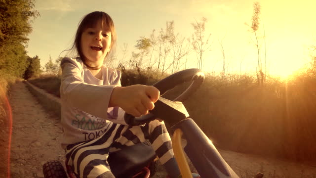 Happy Memories Of Her Young Days- A Child of Tree Drive Go-chart, Off-Road POV, User Generated Content. A Kid of Tree Playing In The Filled. Lens Flare, Unusual Angle, GoPro. go cart stock videos & royalty-free footage