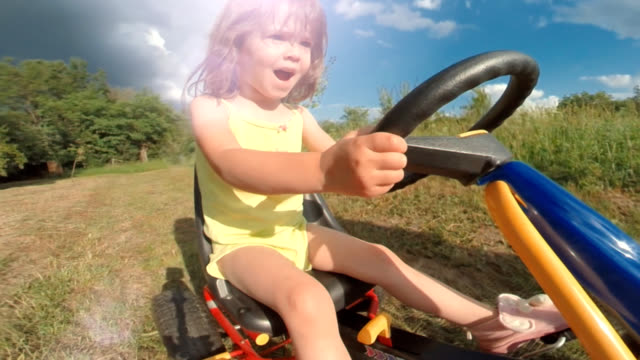 Happy Memories Of Her Young Days User Generated Content. A Kid of Two Playing In The Filled. Lens Flair, Slow Motion, Unusual Angle, GoPro. go cart stock videos & royalty-free footage