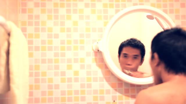 Happy men brushing teeth video