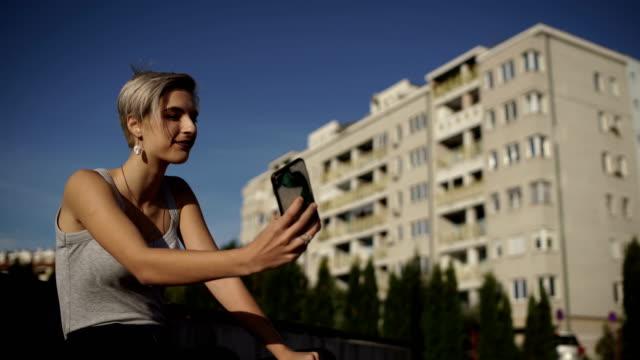 happy millennial teenage girl take a selfie video