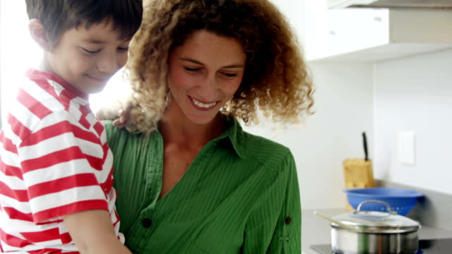 Happy mom and son cooking video