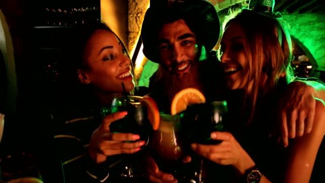Happy multi-ethnic friends celebrating Saint Patrick's day at Irish bar video