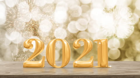 Happy New Year 2021 gold glossy with fireworks on modern wood table and leg with sparkling gold bokeh wall,Holiday celebration concept Happy New Year 2021 gold glossy with fireworks on modern wood table and leg with sparkling gold bokeh wall,Holiday celebration concept happy new year stock videos & royalty-free footage
