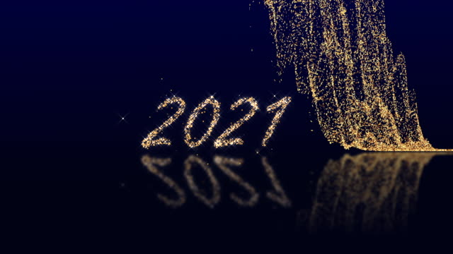 2021 Happy New Year. Gold glitter on dark blue. The appearance of text from glowing particles. 2021 Happy New Year. Gold glitter on dark blue. The appearance of text from glowing particles. happy new year 2021 stock videos & royalty-free footage