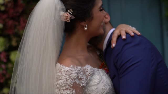 Happy newlywed couple kissing at the chapel