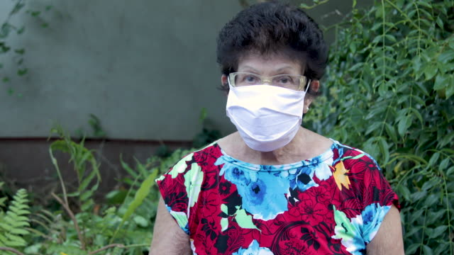 happy old woman smiling happy in old age use mask in prevention video