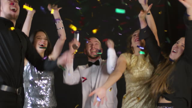 Happy People Dancing and Shooting Confetti