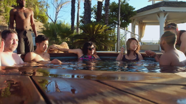Happy People Enjoying Hot Tub at Pool Party video