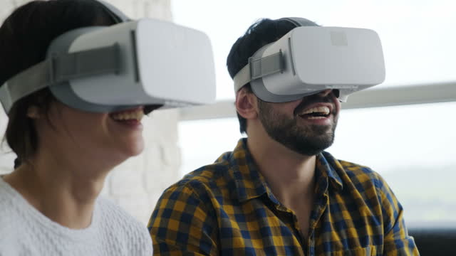 Happy People Smiling And Enjoying VR Game At Home