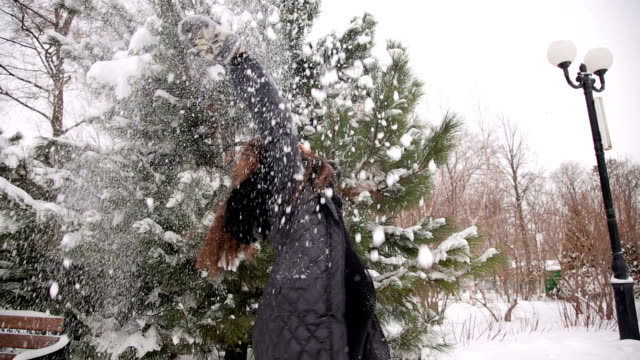 happy pregnant woman throws snow up in the air. - forest bathing video stock e b–roll