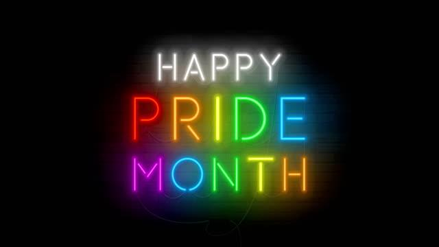 happy pride month migocząc neonowy symbol lgbt - miesiąc filmów i materiałów b-roll