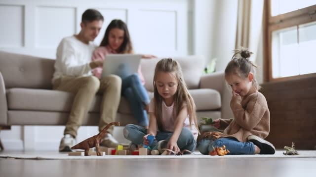 Happy relaxed family enjoy leisure activities lifestyle in living room