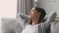 istock Happy relaxed woman rest lounge on couch enjoy peaceful day 1177224721
