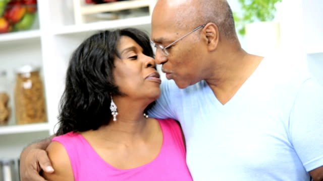 happy retired couple close up exchanging kiss - heterosexual couple stock videos and b-roll footage