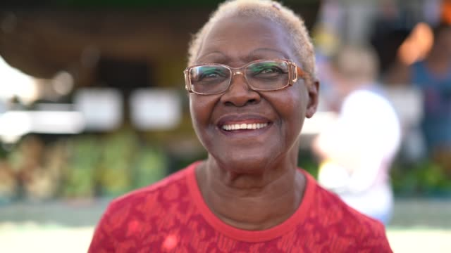 happy senior african ethnicity woman portrait - seniors stock videos & royalty-free footage