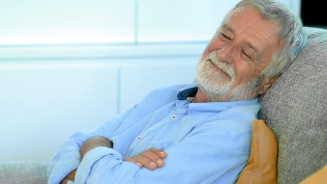 happy senior napping - sonnecchiare video stock e b–roll