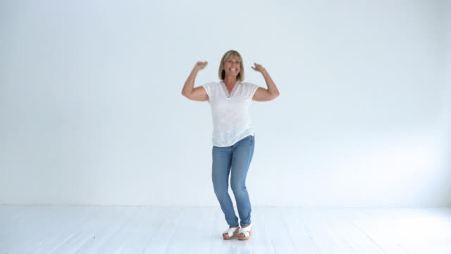 Happy senior woman smiling and jumping up and down video