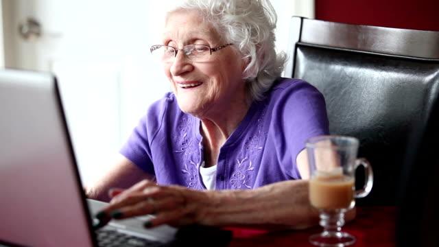 Happy Senior Woman Using Laptop video