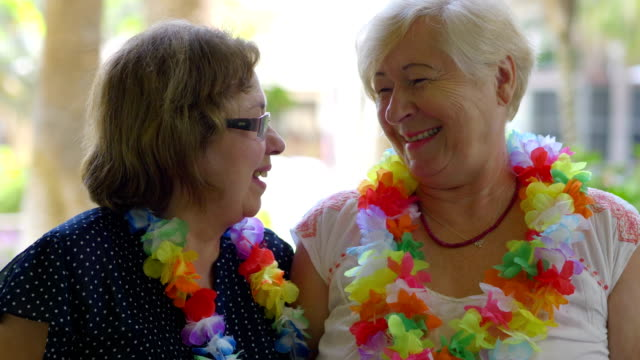 Happy senior women having fun on the vacation in 4k slow motion 60fps video