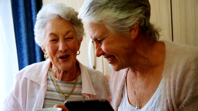 Happy senior women using digital tablet 4k video