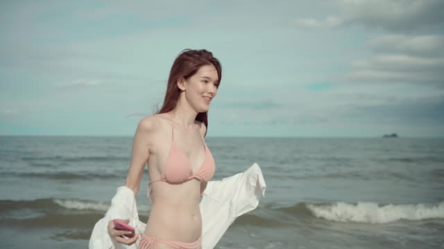 Happy Sexy Woman transgender Walks on the Beach Happy Sexy asian Woman transgender Walks on the Beach transsexual stock videos & royalty-free footage