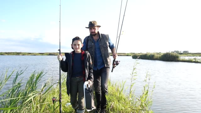 Happy smile father and son go fishing together