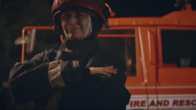 happy smile firewoman. - släcka bildbanksvideor och videomaterial från bakom kulisserna