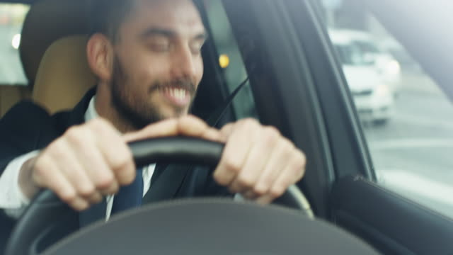 Happy Smiling Businessman Driving a Car video