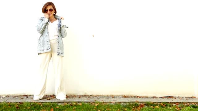 Happy smiling elegant woman in denim jacket