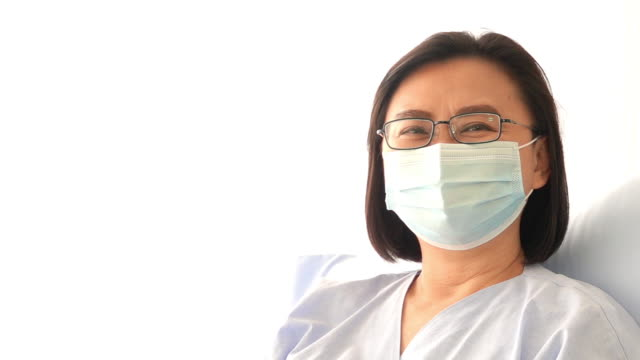 Happy smiling patient female wearing protective medical face mask video